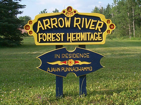 [arrow river sign]